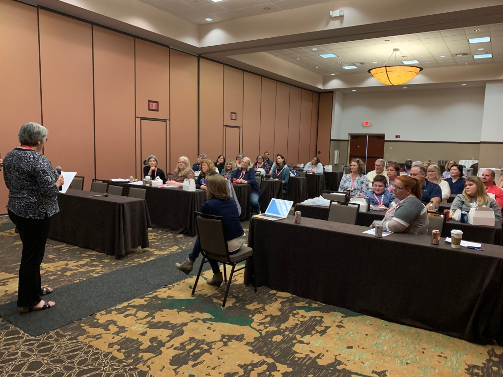 Photo of WAER members at the 2019 Annual Meeting. Trudy Stachowiak is leading the meeting.